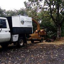 Cutting Edge Tree Management Ute with a wood chipper